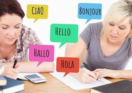 vocational high school: Digital composite of Hello in different languages chat bubbles learning with students Stock Photo
