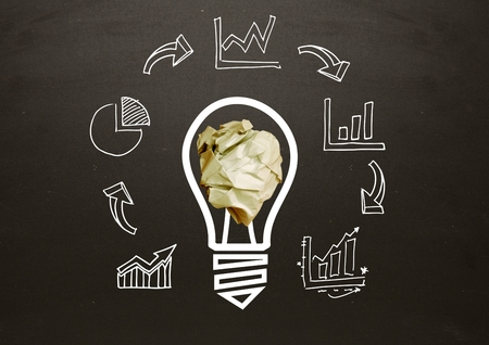 biege: Digital composite of light bulb with crumpled paper ball and business graphics in front of blackboard Stock Photo