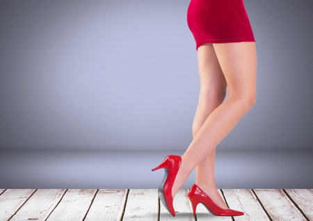 Digital composite of Sexy womans legs with red skirt and shoes in front of grey background