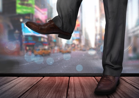 Digital composite of Mans legs and feet in front of city