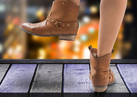 Digital composite of Woman's feet with Party boots  over night city