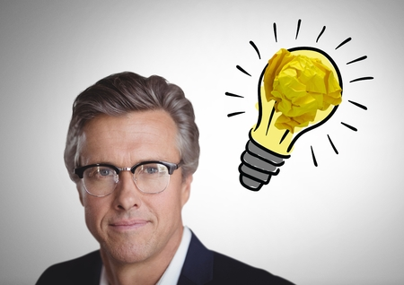 Digital composite of Man  next to light bulb with crumpled paper ball
