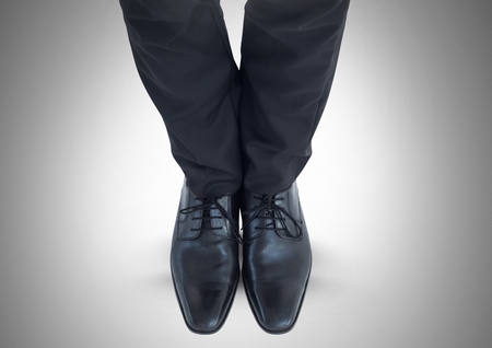 Digital composite of Mans legs and feet in black suit and shoes Stock Photo