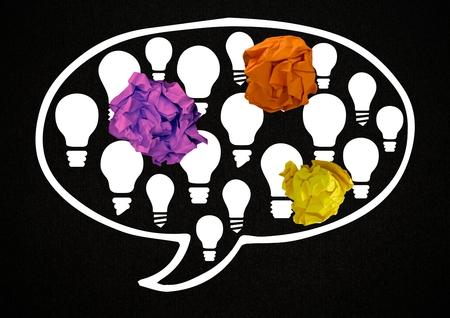 Digital composite of light bulb chat bubble with crumpled paper balls Banco de Imagens - 83190864
