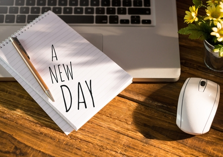 brogues: Digital composite of A New Day  text written on page with laptop