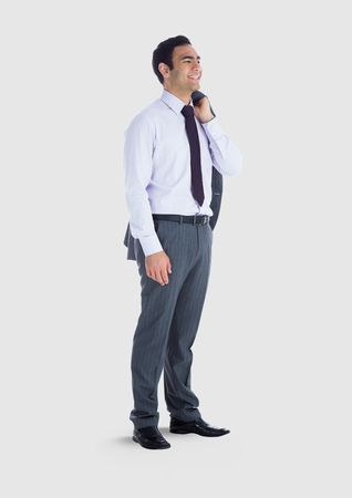 quaver: Digital composite of Full body portrait of man standing with grey background