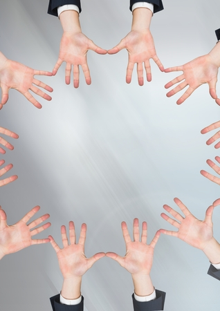 Digital composite of Hands in circle with grey background