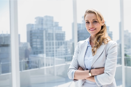 scrolling: Digital composite of Happy business woman standing against city background