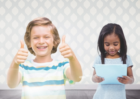 floorboards: Digital composite of kids holding tablet with room background Stock Photo