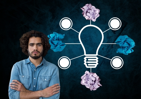 3d ball: Digital composite of Man standing next to light bulb with crumpled paper balls Stock Photo