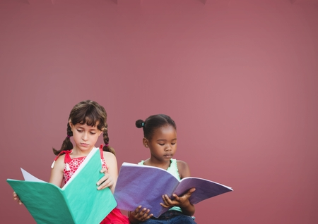 floorboards: Digital composite of Kids reading in front of pink background Stock Photo