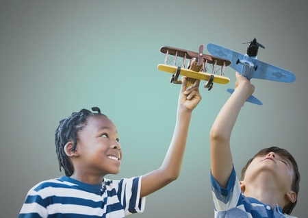 Digital composite of kids playing with toy planes together with blank background Stock Photo