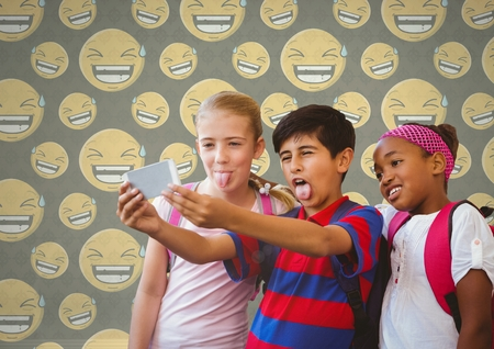 Digital composite of Kids taking selfie in blank room with smiley faces laughing Imagens