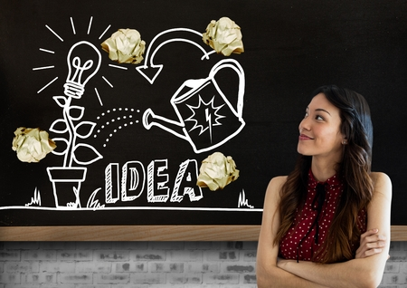 causal: Digital composite of Woman standing next to light bulb and ideas drawings garden with crumpled paper balls  in front of b