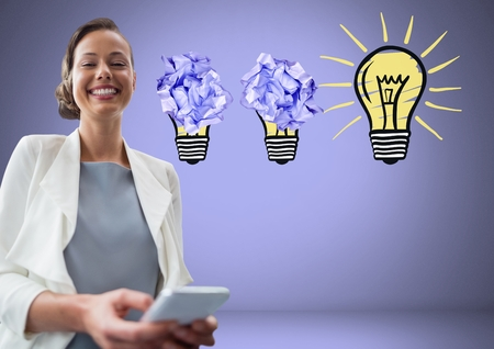 Digital composite of Woman on tablet standing next to light bulbs with crumpled paper balls Stock Photo