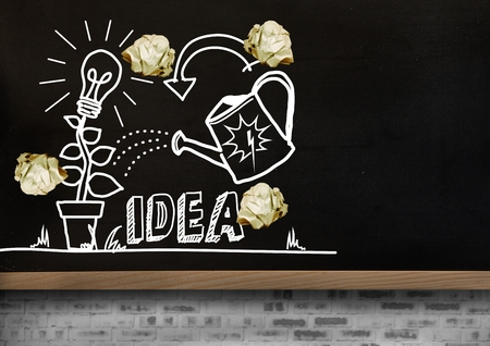 Digital composite of light bulb and ideas drawings garden with crumpled paper balls  in front of blackboard Stok Fotoğraf