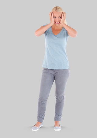 Digital composite of Full body portrait of stressed woman standing with grey background