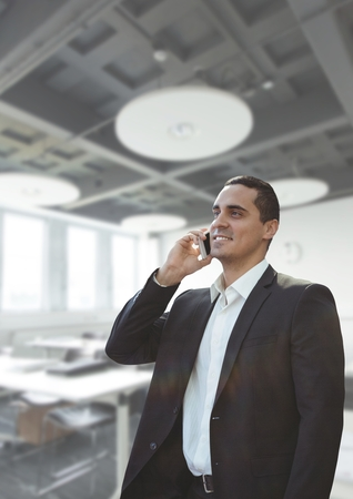 businesswear: Digital composite of Business man talking on the phone against office background Stock Photo
