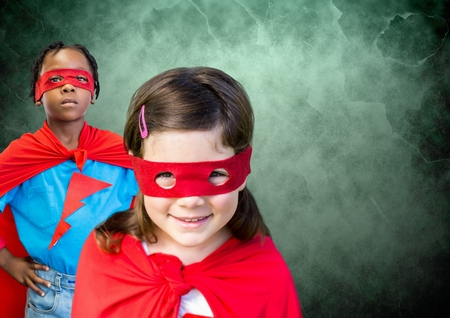 Digital composite of Superhero kids in front of green background
