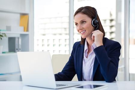 customer service representative: Digital composite of Happy customer care representative woman against office background