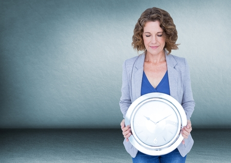 career fair: Digital composite of Woman holding clock in front of room