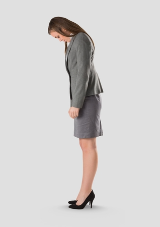 Digital composite of Full body portrait of woman standing with grey background Archivio Fotografico