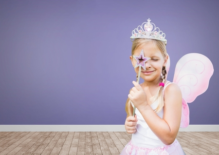 Digital composite of Princess girl in blank room with purple background Stock Photo