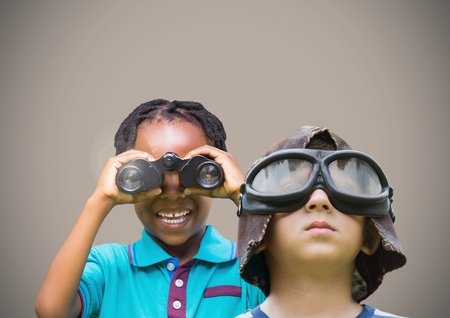 man made: Digital composite of kids holding binoculars with blank brown background Stock Photo