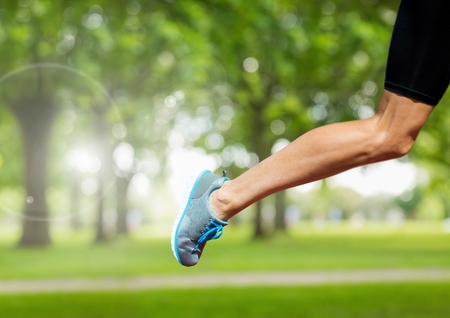 technology transaction: Digital composite of Athletic Leg running in park Stock Photo