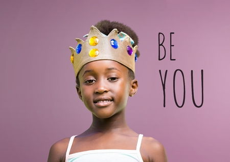 Digital composite of Be you text with Girl wearing crown with blank purple background 스톡 콘텐츠