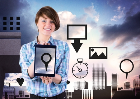 Digital composite of Holding tablet and City with icons Stock Photo