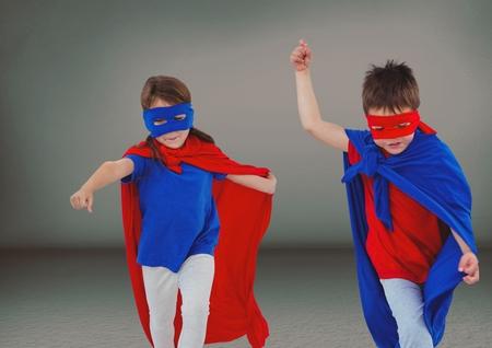 companionship: Digital composite of Superhero kids with blank grey background
