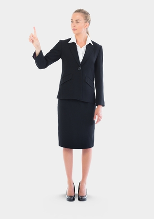 career fair: Digital composite of Full body portrait of woman touching air and standing with grey background