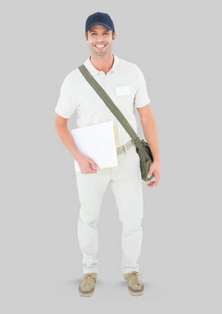Digital composite of Full body portrait of courier Man standing with grey background