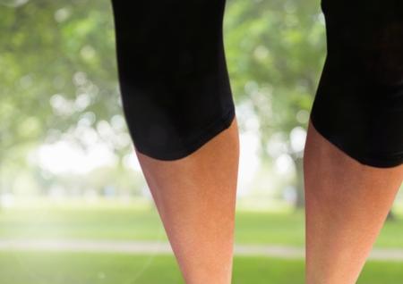 Digital composite of Athletic slim legs in park