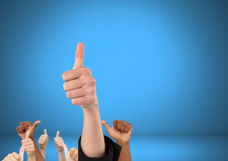 Digital composite of Hands with thumbs up in front of blue background