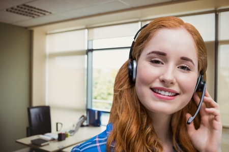 Digital composite of Happy customer care representative woman against office background