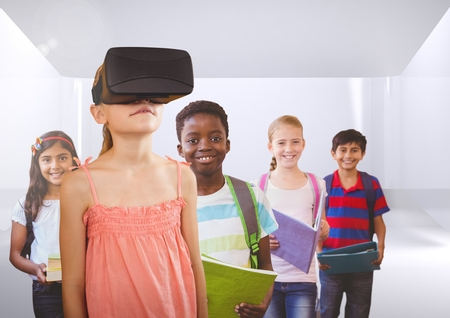Digital composite of Kids with VR headset in room Stock Photo