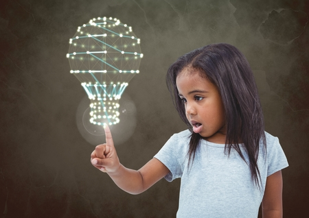 Digital composite of Girl touching flare glow with green background and light bulb interface Stock Photo