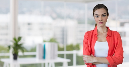 Digital composite of Business woman standing against office background