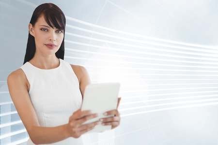 Digital composite of Business woman holding a tablet against white and blue background