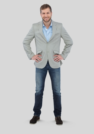 Digital composite of Full body portrait of Man standing with grey background