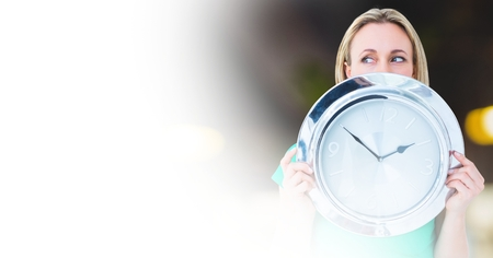 Digital composite of Woman holding clock in front of room