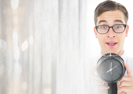 Digital composite of man holding clock in front of bright light