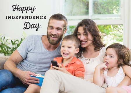 Digital composite of Smiling american family sitting on a couch