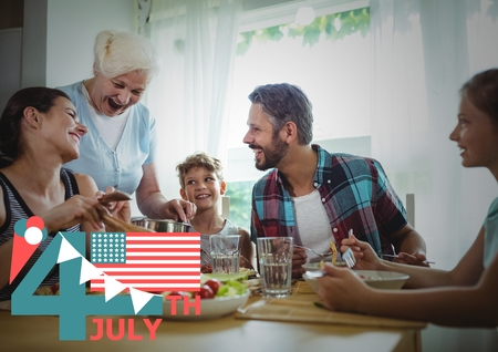 Digital composite of Fourth of July graphic with flags and ice cream against family dinner Stock Photo