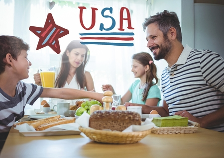 jag: Digital composite of American family sitting around a table for 4th of July dinner