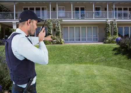 Digital composite of Security guard talking on radio while pointing at house