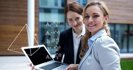 Digital composite of Digital composite image of businesswomen planning strategies on laptop