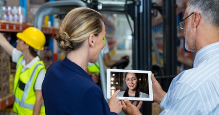 businesswear: Digital composite of Man and woman video conferencing with colleague